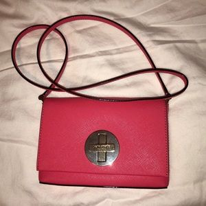 Kate Spade mini Crossbody purse (fuchsia color)